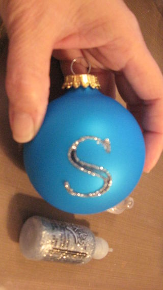 stamped and outlined glitter ornament