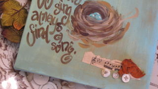 Added vintage buttons, vintage seam binding and vintage sheet music to this painted canvas.