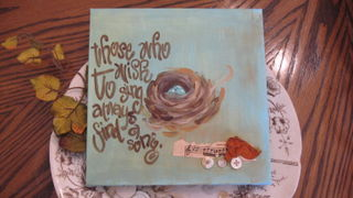 Painted, embelleshed canvas by me.