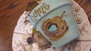Little Robins Egg Blue pot painted with a nest. All it needs is ivy.