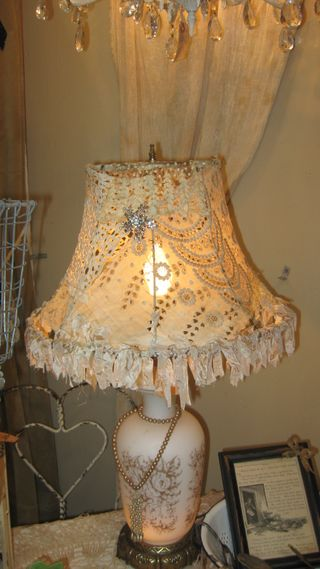 Adorable lace and jewel adorned lamp shade.