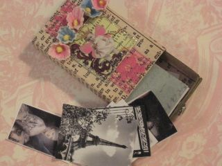 Adorable little matchbox filled with tiny images by Lisa.