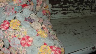Shabby aqua bench with wonderful yo-yo throw