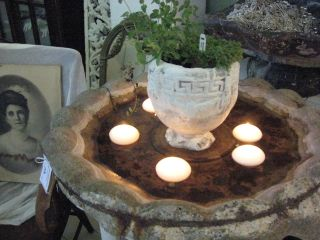Loved this...these chandles floating in an old bird bath.