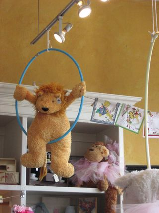 A Lion takes a swing on a Hula Hoop in the kid's area!