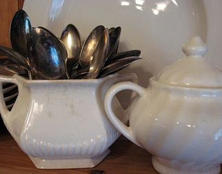 Grottie old silver spoons that I adore. Vintage sugar bowls and Dollar Tree plates.